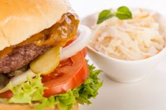 Cheeseburger with cole slaw Stock Photography