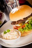 Cheeseburger with cole slaw Stock Image