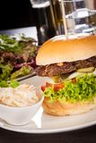 Cheeseburger with cole slaw Royalty Free Stock Image