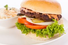 Cheeseburger with cole slaw Royalty Free Stock Images