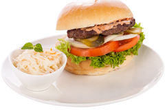 Cheeseburger with cole slaw Stock Images