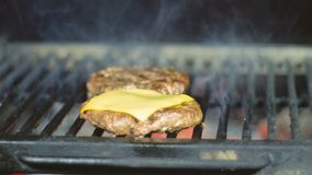 Cheeseburger cutlets cooked on a barbecue grill for country holiday weekend stock video footage