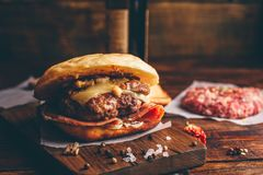 Cheeseburger on Cutting Board. With Bottle of Craft Beer stock photos