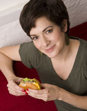 Woman Holds Cheeseburger Between Bites Eating Royalty Free Stock Photography