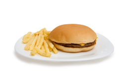Cheeseburger on dinner plate with french fries Royalty Free Stock Photo