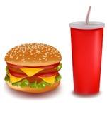 Cheeseburger doble con la bebida. Foto de archivo