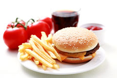 Cheeseburger and french fries Stock Photography