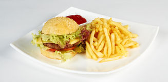 Cheeseburger with french fries. And dips isolated on a white Stock Photo