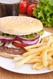 Cheeseburger, french fries and cola Stock Images