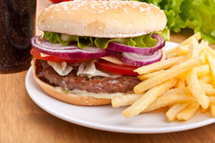 Cheeseburger, french fries and cola royalty free stock photos