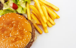 Cheeseburger and french fries of meal on background. Stock Images