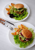 Cheeseburger and french fries Stock Photos