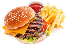Cheeseburger with French fries. And tomato sauce isolated on white background royalty free stock photography