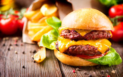 Cheeseburger with fresh salad and french fries Stock Photo
