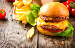 Cheeseburger with fresh salad and french fries Stock Photography