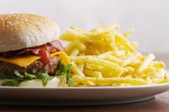 Cheeseburger with fries. Bacon cheeseburger with fries with white background Stock Photos