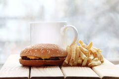 Cheeseburger and fries, breakfast Stock Images