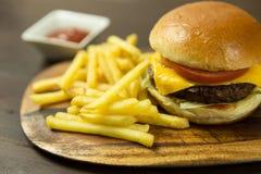 Cheeseburger and fries. Closeup shot of cheeseburger and fries stock photo