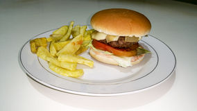 Cheeseburger and fries. Composition work in progres Royalty Free Stock Photos
