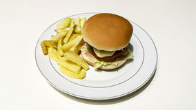 Cheeseburger and fries. Composition work in progres Royalty Free Stock Photo