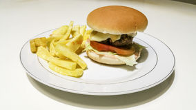 Cheeseburger and fries. Composition work in progres Stock Photos