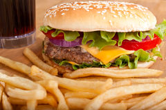 Cheeseburger with fries and a drink Royalty Free Stock Photo