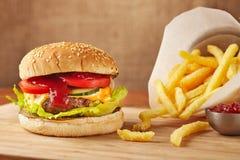 Cheeseburger and fries Royalty Free Stock Image
