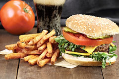 Cheeseburger and Fries Stock Images