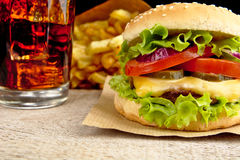 Cheeseburger,glass of cola and french fries on wooden Stock Photo