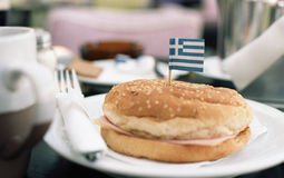 Cheeseburger. With greek flag on the plate Stock Photos