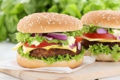 Cheeseburger hamburger burger tomatoes cheese. Unhealthy royalty free stock image