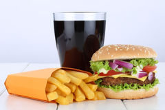 Cheeseburger hamburger and fries menu meal combo cola drink unhealthy eating royalty free stock photos
