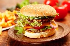 Cheeseburger. Homemade vegetarian Cheeseburger with French fries royalty free stock photos