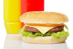 Cheeseburger with mustard and ketchup Stock Images