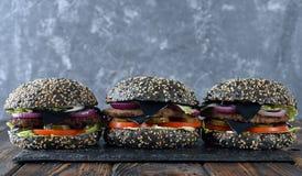 Cheeseburger negro foto de archivo