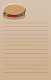 Cheeseburger-Notizblock lizenzfreie stockbilder