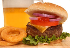 Cheeseburger with onion rings and beer Stock Images