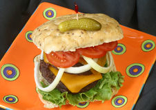 Cheeseburger, Onion, Tomato Royalty Free Stock Images