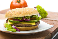 Cheeseburger with Onions and Lettuce Stock Photos