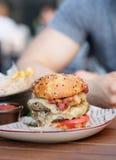 Cheeseburger in outdoor restaurant Stock Photos
