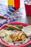 Cheeseburger at a patriotic themed cookout Royalty Free Stock Photo