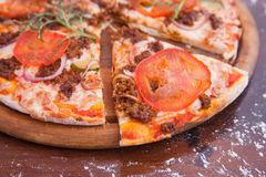 Cheeseburger Pizza on Wooden Background Stock Photography