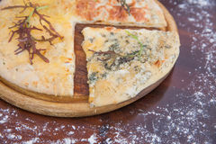 Cheeseburger Pizza on Wooden Background Royalty Free Stock Images