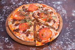 Cheeseburger Pizza on Wooden Background Royalty Free Stock Image