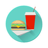 Cheeseburger with plastic cup on a napkin. Flat Stock Photos