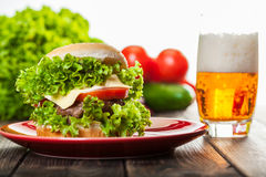 Cheeseburger on a plate with beer Royalty Free Stock Photography