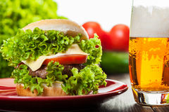 Cheeseburger on a plate with beer Royalty Free Stock Photo