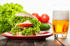 Cheeseburger on a plate with beer Stock Photography
