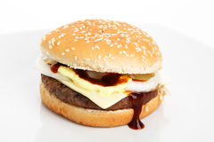 Cheeseburger. On a plate with white backgraound stock photo