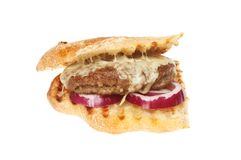 Cheeseburger and red onion in ciabatta royalty free stock image